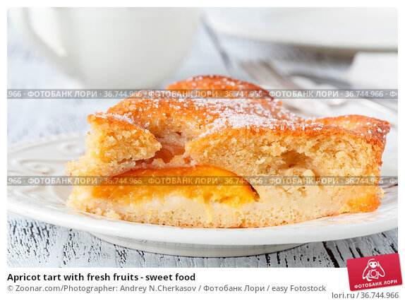 Apricot tart with fresh fruits - sweet food. Стоковое фото, фотограф Zoonar.com/Photographer: Andrey N.Cherkasov / easy Fotostock / Фотобанк Лори