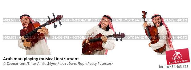 Arab man playing musical instrument. Стоковое фото, фотограф Zoonar.com/Elnur Amikishiyev / easy Fotostock / Фотобанк Лори