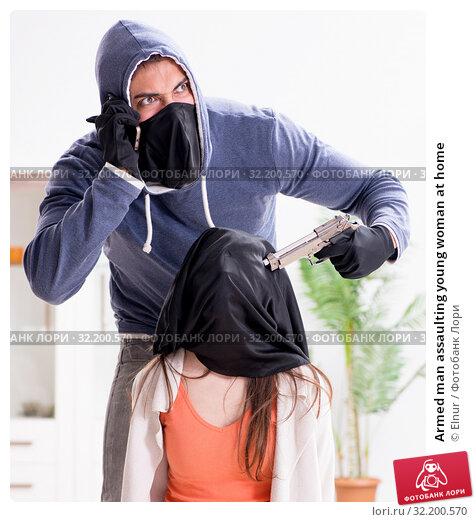 Купить «Armed man assaulting young woman at home», фото № 32200570, снято 15 декабря 2017 г. (c) Elnur / Фотобанк Лори