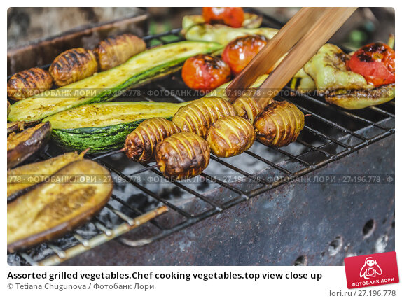 Купить «Assorted grilled vegetables.Chef cooking vegetables.top view close up», фото № 27196778, снято 28 июля 2017 г. (c) Tetiana Chugunova / Фотобанк Лори
