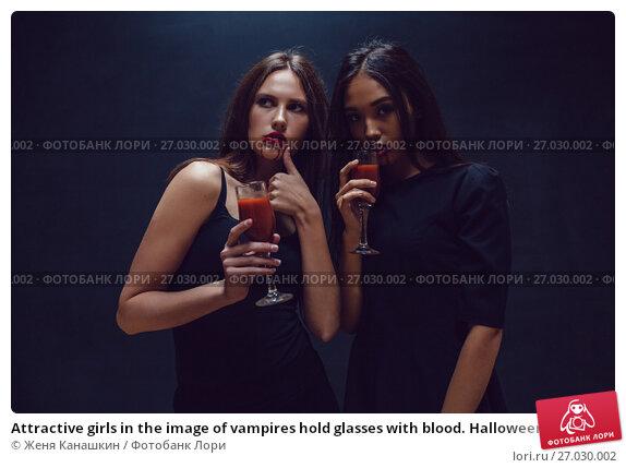 Купить «Attractive girls in the image of vampires hold glasses with blood. Halloween.», фото № 27030002, снято 22 сентября 2017 г. (c) Женя Канашкин / Фотобанк Лори