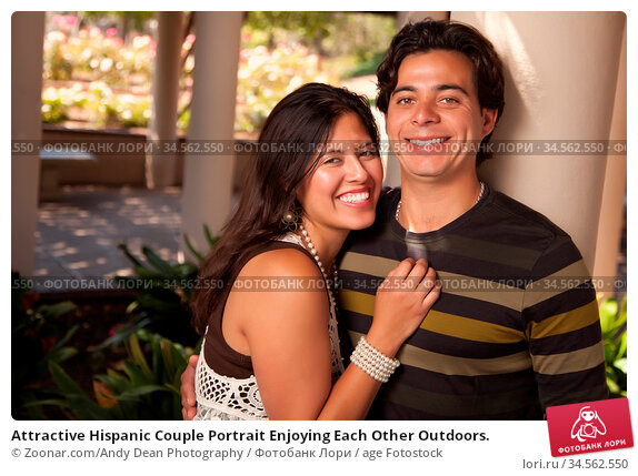 Attractive Hispanic Couple Portrait Enjoying Each Other Outdoors. Стоковое фото, фотограф Zoonar.com/Andy Dean Photography / age Fotostock / Фотобанк Лори