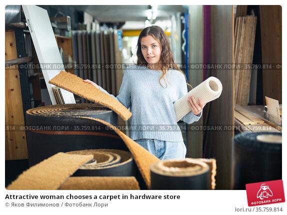Attractive woman chooses a carpet in hardware store. Стоковое фото, фотограф Яков Филимонов / Фотобанк Лори