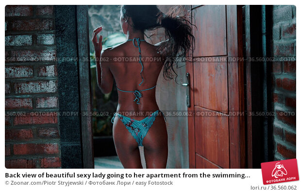 Back view of beautiful sexy lady going to her apartment from the swimming... Стоковое фото, фотограф Zoonar.com/Piotr Stryjewski / easy Fotostock / Фотобанк Лори