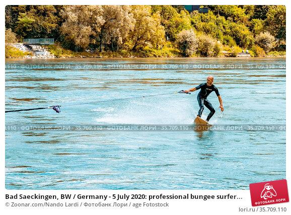 Bad Saeckingen, BW / Germany - 5 July 2020: professional bungee surfer... Стоковое фото, фотограф Zoonar.com/Nando Lardi / age Fotostock / Фотобанк Лори