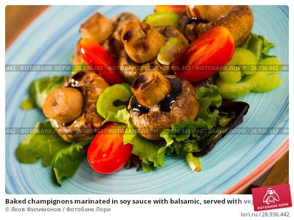 Купить «Baked champignons marinated in soy sauce with balsamic, served with vegetables», фото № 28936442, снято 14 декабря 2019 г. (c) Яков Филимонов / Фотобанк Лори