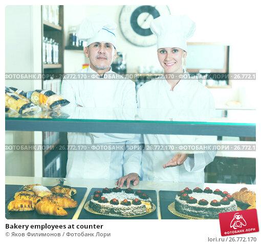 Купить «Bakery employees at counter», фото № 26772170, снято 22 апреля 2017 г. (c) Яков Филимонов / Фотобанк Лори