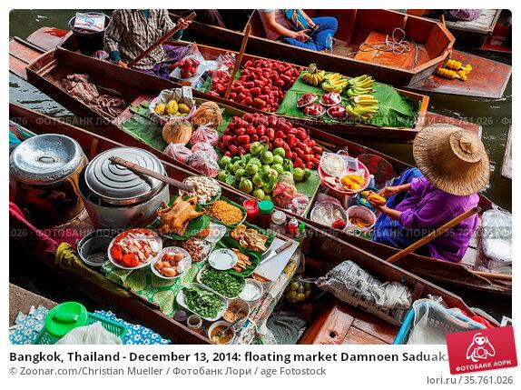 Bangkok, Thailand - December 13, 2014: floating market Damnoen Saduak... Стоковое фото, фотограф Zoonar.com/Christian Mueller / age Fotostock / Фотобанк Лори