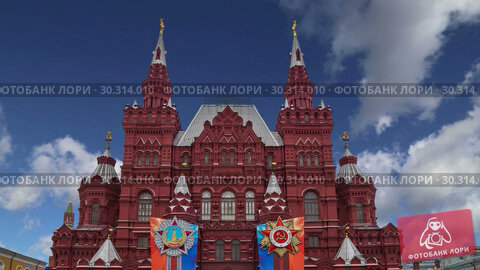 Купить «Banners with medals and ribbons on the facade of Historical museum (Victory Day decoration) against the sky, Red Square, Moscow, Russia», видеоролик № 30314010, снято 15 марта 2019 г. (c) Владимир Журавлев / Фотобанк Лори