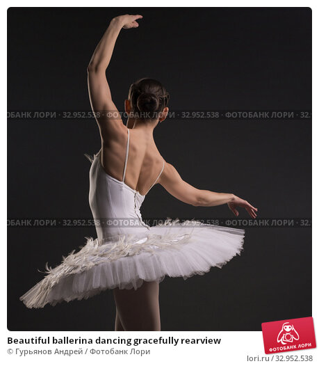 Beautiful ballerina dancing gracefully rearview. Стоковое фото, фотограф Гурьянов Андрей / Фотобанк Лори