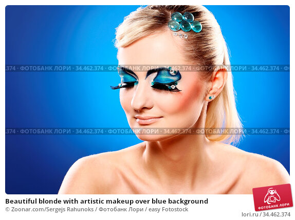 Beautiful blonde with artistic makeup over blue background. Стоковое фото, фотограф Zoonar.com/Sergejs Rahunoks / easy Fotostock / Фотобанк Лори