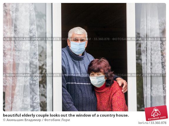 Купить «beautiful elderly couple looks out the window of a country house.», фото № 33360878, снято 29 сентября 2019 г. (c) Акиньшин Владимир / Фотобанк Лори
