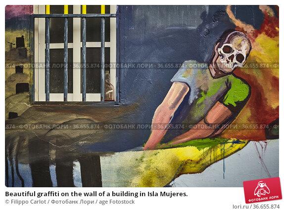 Beautiful graffiti on the wall of a building in Isla Mujeres. Стоковое фото, фотограф Filippo Carlot / age Fotostock / Фотобанк Лори