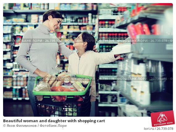 Купить «Beautiful woman and daughter with shopping cart», фото № 26739078, снято 5 января 2017 г. (c) Яков Филимонов / Фотобанк Лори