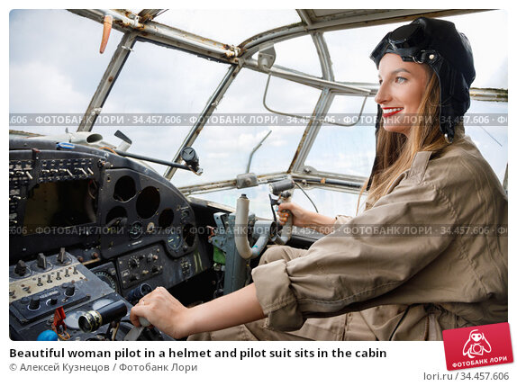 Beautiful woman pilot in a helmet and pilot suit sits in the cabin. Стоковое фото, фотограф Алексей Кузнецов / Фотобанк Лори