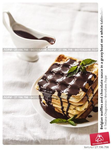 Купить «Belgian waffles and chocolate sauce in a gravy boat on a white tablecloth, background», фото № 27196798, снято 28 августа 2017 г. (c) Tetiana Chugunova / Фотобанк Лори