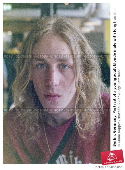 Berlin, Germany. Portrait of a young adult blonde male with long hairdue. Стоковое фото, фотограф Guido Koppes / age Fotostock / Фотобанк Лори