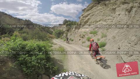 Купить «Bike nature Enduro journey with dirt bike high in the Caucasian mountains, hills, valleys», видеоролик № 28306282, снято 12 апреля 2018 г. (c) Aleksejs Bergmanis / Фотобанк Лори