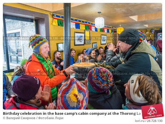 Купить «Birthday celebration in the base camp's cabin company at the Thorong La pass on April 6, 2018 on the track around Annapurna, Nepal», фото № 28728130, снято 6 апреля 2018 г. (c) Валерий Смирнов / Фотобанк Лори