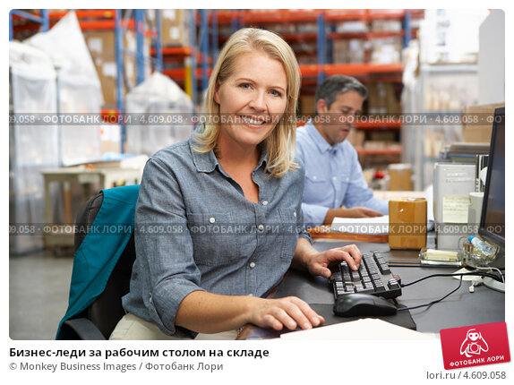Купить «Бизнес-леди за рабочим столом на складе», фото № 4609058, снято 27 октября 2012 г. (c) Monkey Business Images / Фотобанк Лори
