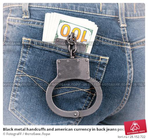 Купить «Black metal handcuffs and american currency in back jeans pocket», фото № 28152722, снято 4 января 2017 г. (c) FotograFF / Фотобанк Лори