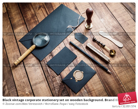 Black vintage corporate stationery set on wooden background. Brand ID elements. Стоковое фото, фотограф Zoonar.com/Alex Veresovich / easy Fotostock / Фотобанк Лори