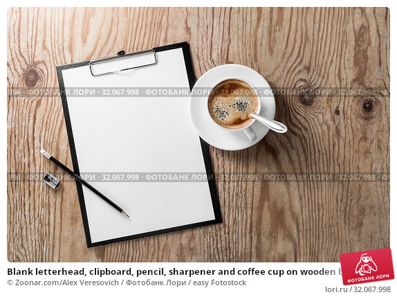 Blank letterhead, clipboard, pencil, sharpener and coffee cup on wooden background. Responsive design template. Стоковое фото, фотограф Zoonar.com/Alex Veresovich / easy Fotostock / Фотобанк Лори