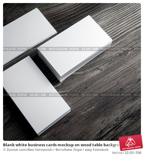 Blank white business cards mockup on wood table background. Стоковое фото, фотограф Zoonar.com/Alex Veresovich / easy Fotostock / Фотобанк Лори