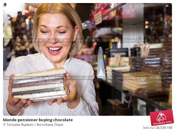 Купить «blonde pensioner buying chocolate», фото № 28539190, снято 15 февраля 2016 г. (c) Татьяна Яцевич / Фотобанк Лори