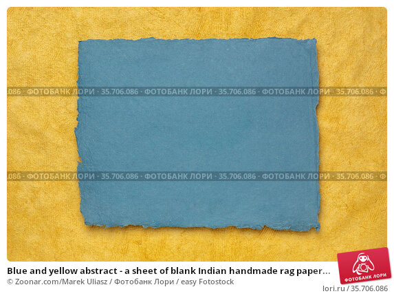 Blue and yellow abstract - a sheet of blank Indian handmade rag paper... Стоковое фото, фотограф Zoonar.com/Marek Uliasz / easy Fotostock / Фотобанк Лори