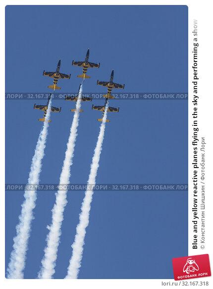 Купить «Blue and yellow reactive planes flying in the sky and performing a show», фото № 32167318, снято 30 августа 2019 г. (c) Константин Шишкин / Фотобанк Лори