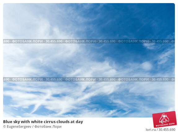Blue sky with white cirrus clouds at day. Стоковое фото, фотограф EugeneSergeev / Фотобанк Лори