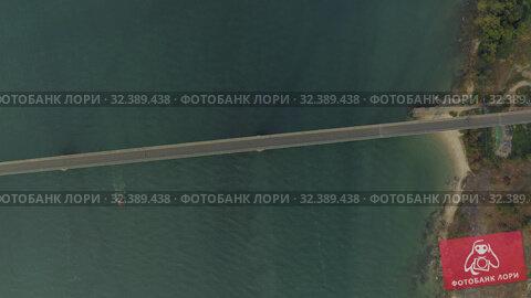 Купить «Bridge over the sea, asphalt road blue water Drone shot in Cambodia», видеоролик № 32389438, снято 26 октября 2019 г. (c) Aleksejs Bergmanis / Фотобанк Лори