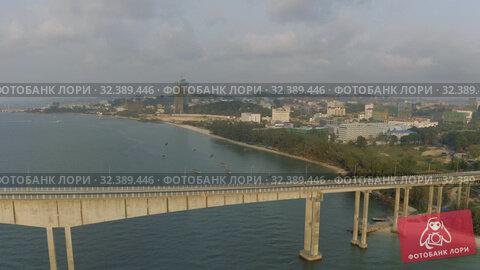 Купить «Bridge over the sea, asphalt road blue water Drone shot in Cambodia», видеоролик № 32389446, снято 26 октября 2019 г. (c) Aleksejs Bergmanis / Фотобанк Лори