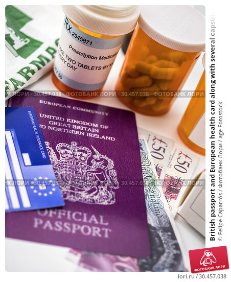 British passport and European health card along with several capsules, concept of medical price in the crisis of Brexit, conceptual image, vertical composition. Стоковое фото, фотограф Felipe Caparrós / age Fotostock / Фотобанк Лори