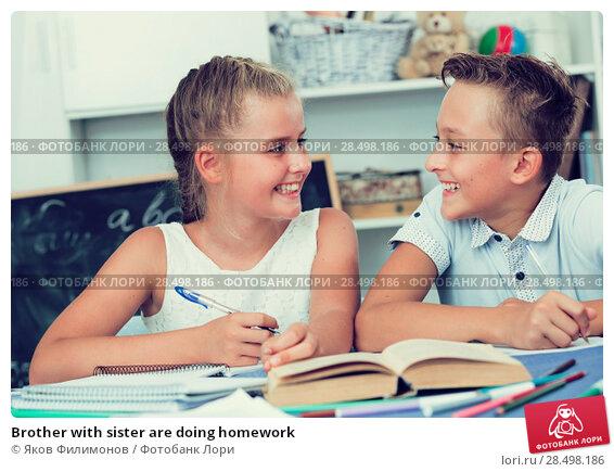 Купить «Brother with sister are doing homework», фото № 28498186, снято 26 июня 2019 г. (c) Яков Филимонов / Фотобанк Лори