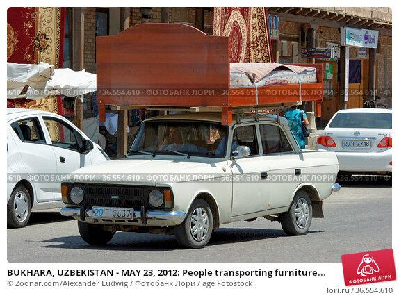 BUKHARA, UZBEKISTAN - MAY 23, 2012: People transporting furniture... Стоковое фото, фотограф Zoonar.com/Alexander Ludwig / age Fotostock / Фотобанк Лори