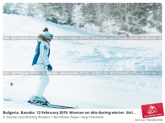 Bulgaria. Bansko. 12 February 2019. Woman on skis during winter. Girl... Стоковое фото, фотограф Zoonar.com/Dmitriy Bruskov / easy Fotostock / Фотобанк Лори