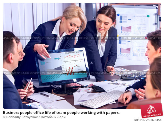 Купить «Business people office life of team people working with papers.», фото № 28169454, снято 29 марта 2017 г. (c) Gennadiy Poznyakov / Фотобанк Лори