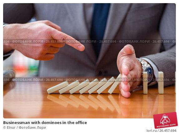 Купить «Businessman with dominoes in the office», фото № 26457694, снято 31 января 2017 г. (c) Elnur / Фотобанк Лори
