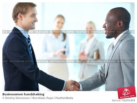 Businessmen handshaking. Стоковое фото, фотограф Dmitriy Shironosov / PantherMedia / Фотобанк Лори