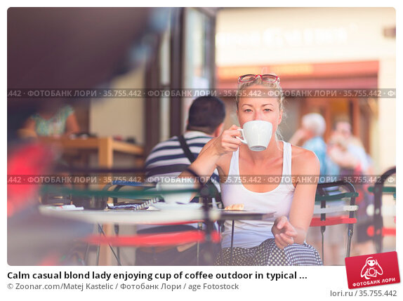 Calm casual blond lady enjoying cup of coffee outdoor in typical ... Стоковое фото, фотограф Zoonar.com/Matej Kastelic / age Fotostock / Фотобанк Лори