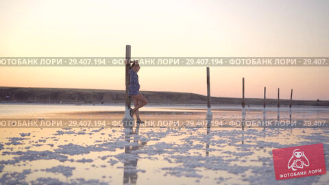 Купить «Calm girl enjoying sun, walking slowly through the water of a salt lake», видеоролик № 29407194, снято 3 ноября 2018 г. (c) Ирина Мойсеева / Фотобанк Лори
