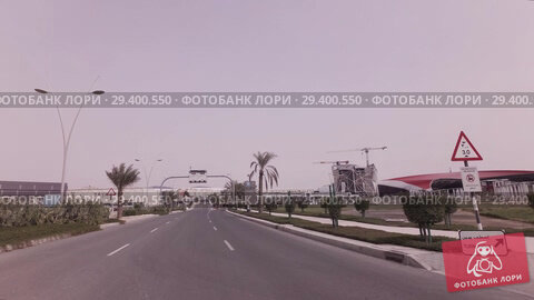 Купить «Car trip to the Ferrari World Yas Island in Abu Dhabi stock footage video», видеоролик № 29400550, снято 3 апреля 2018 г. (c) Юлия Машкова / Фотобанк Лори