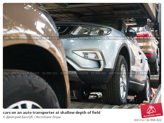 cars on an auto transporter at shallow depth of field. Стоковое фото, фотограф Дмитрий Бачтуб / Фотобанк Лори