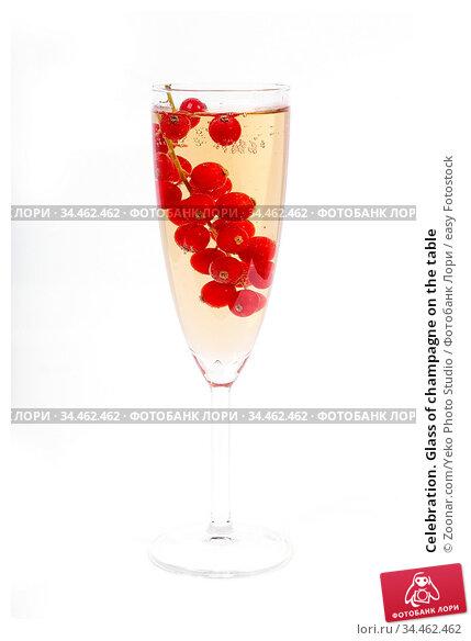 Celebration. Glass of champagne on the table. Стоковое фото, фотограф Zoonar.com/Yeko Photo Studio / easy Fotostock / Фотобанк Лори