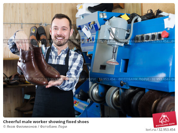 Cheerful male worker showing fixed shoes. Стоковое фото, фотограф Яков Филимонов / Фотобанк Лори