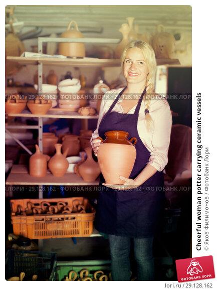Купить «Cheerful woman potter carrying ceramic vessels», фото № 29128162, снято 19 февраля 2019 г. (c) Яков Филимонов / Фотобанк Лори