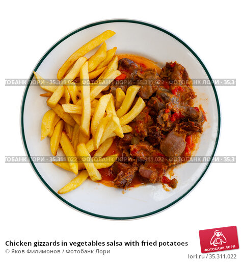 Chicken gizzards in vegetables salsa with fried potatoes. Стоковое фото, фотограф Яков Филимонов / Фотобанк Лори