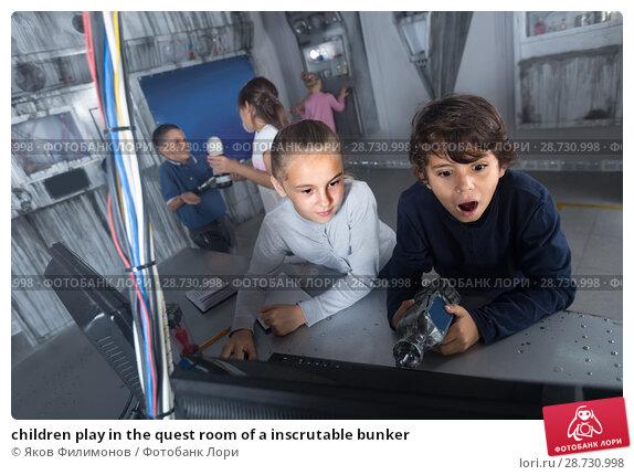 Купить «children play in the quest room of a inscrutable bunker», фото № 28730998, снято 21 октября 2017 г. (c) Яков Филимонов / Фотобанк Лори